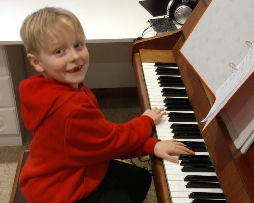 Piano student in a lesson